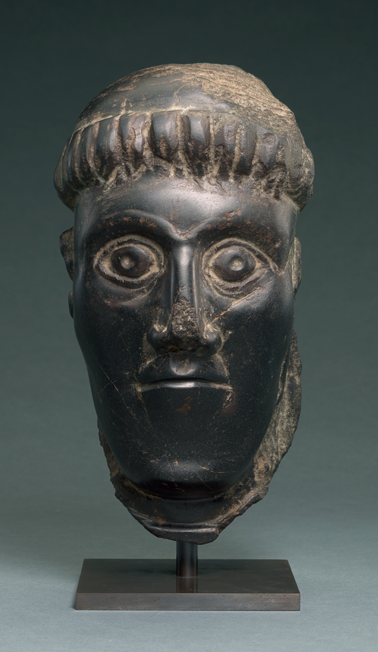 IRISH, CIRCA 11TH CENTURY | HEAD OF A BISHOP SAINT