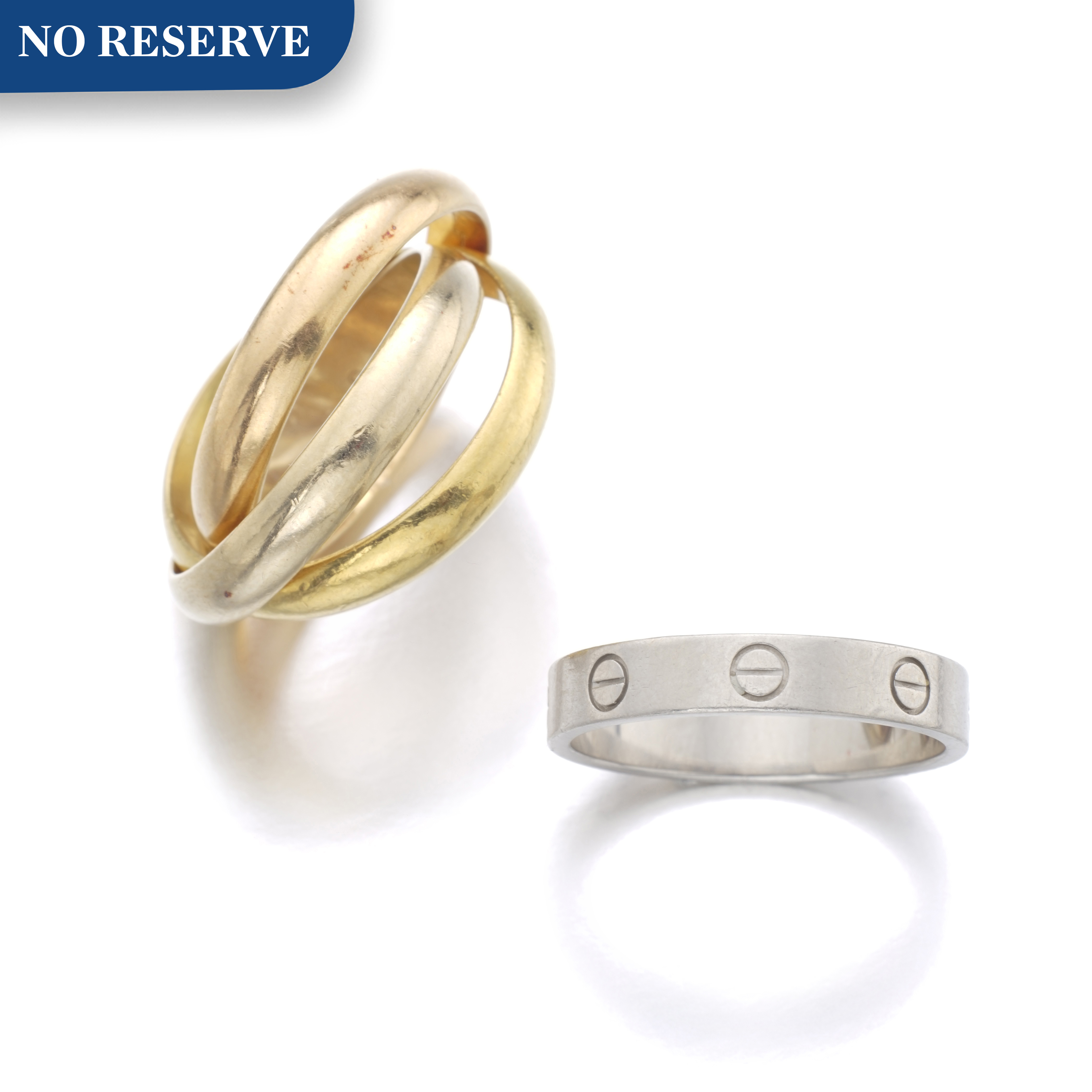 View full screen - View 1 of Lot 146. CARTIER   RING, 'LOVE', AND RING, 'TRINITY'.