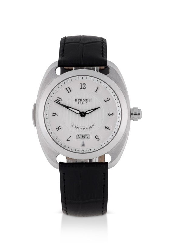 View full screen - View 1 of Lot 99. HERMÈS   DRESSAGE L'HEURE MASQUÉE, REF DR5.810 LIMITED EDITION STAINLESS STEEL DUAL TIME WRISTWATCH WITH HIDDEN HOUR HAND CIRCA 2015.