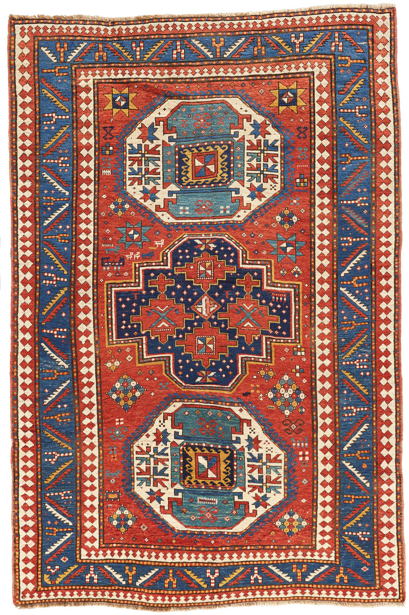A KAZAK TRIPLE MEDALLION RUG, WEST CAUCASUS