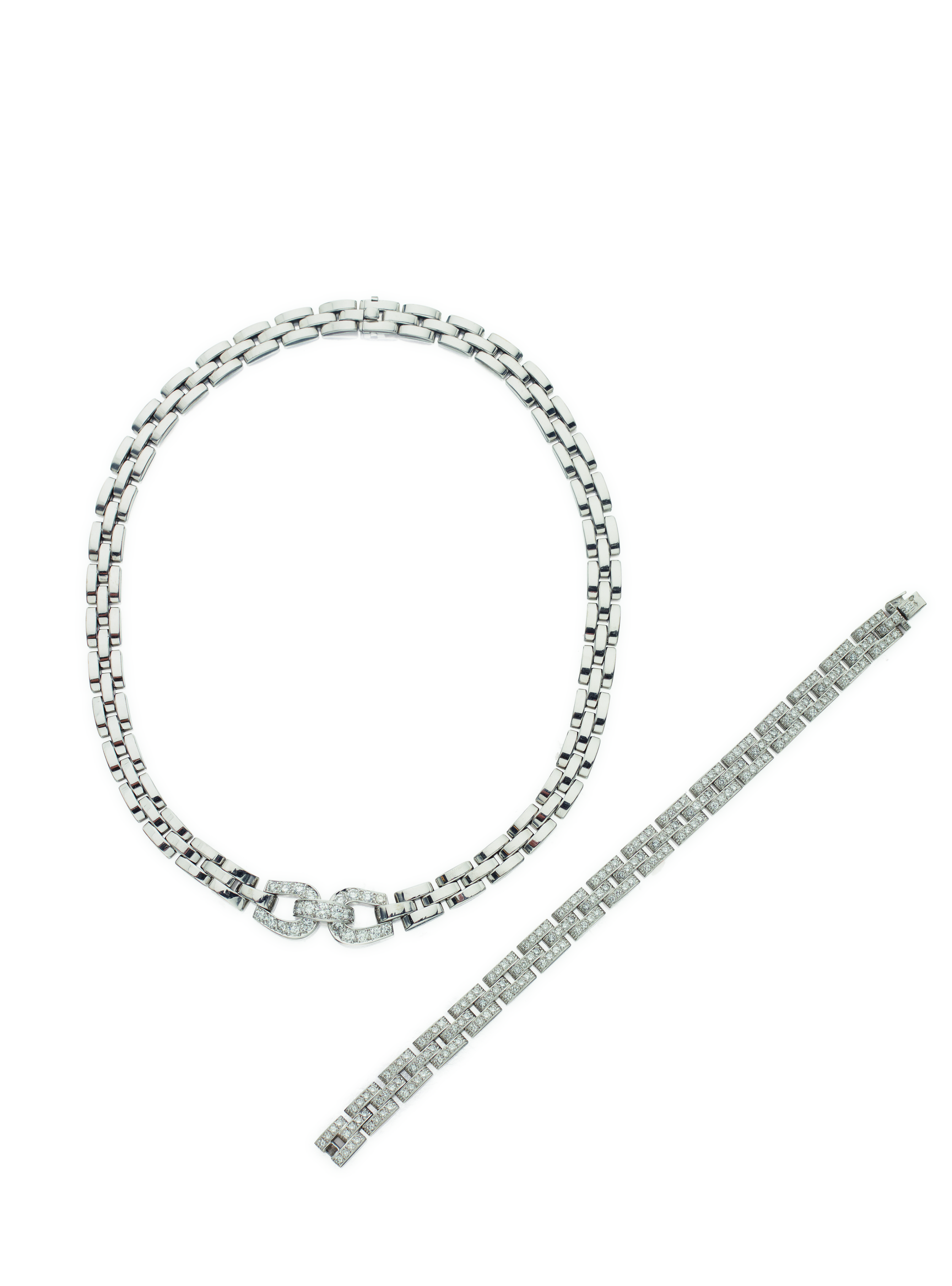 View 1 of Lot 22. WHITE GOLD AND DIAMOND 'PANTHÈRE' NECKLACE AND BRACELET, CARTIER, FRANCE.