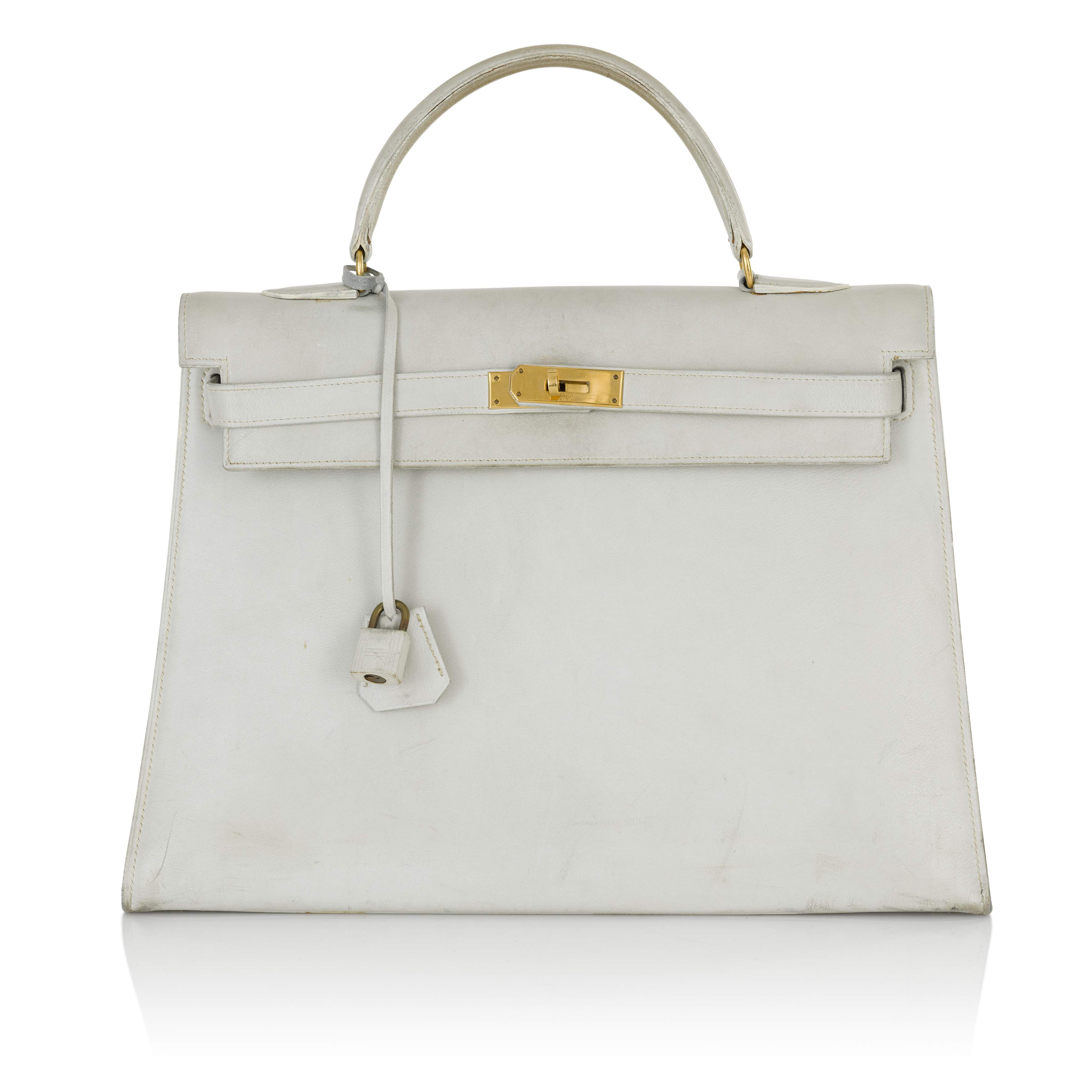 View full screen - View 1 of Lot 12.  HERMÈS | WHITE VINTAGE KELLY SELLIER 32 IN VACHE LEATHER WITH GOLD HARDWARE, CIRCA 1960s.
