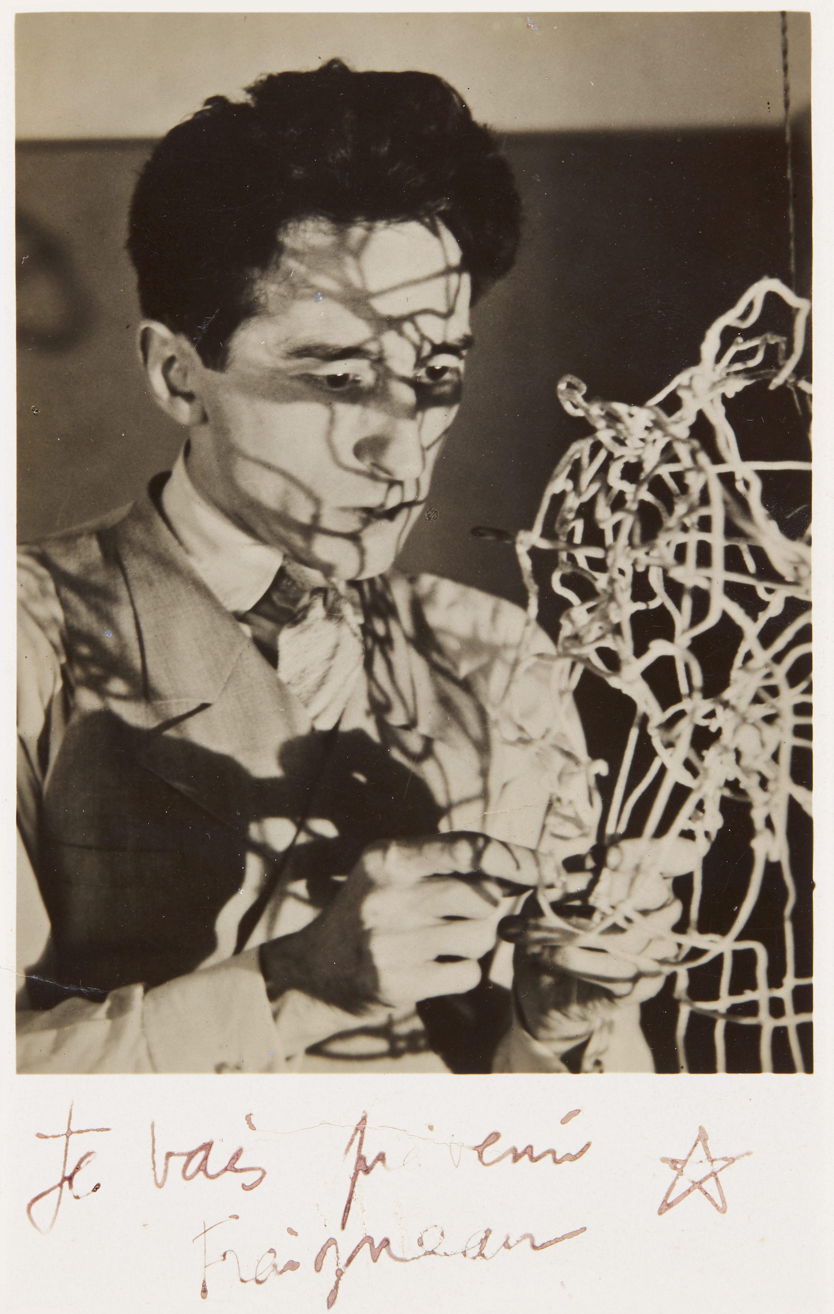 View full screen - View 1 of Lot 64. MAN RAY | 'JEAN COCTEAU WITH SELF-PORTRAIT WIRE STRUCTURE', CA.1925.