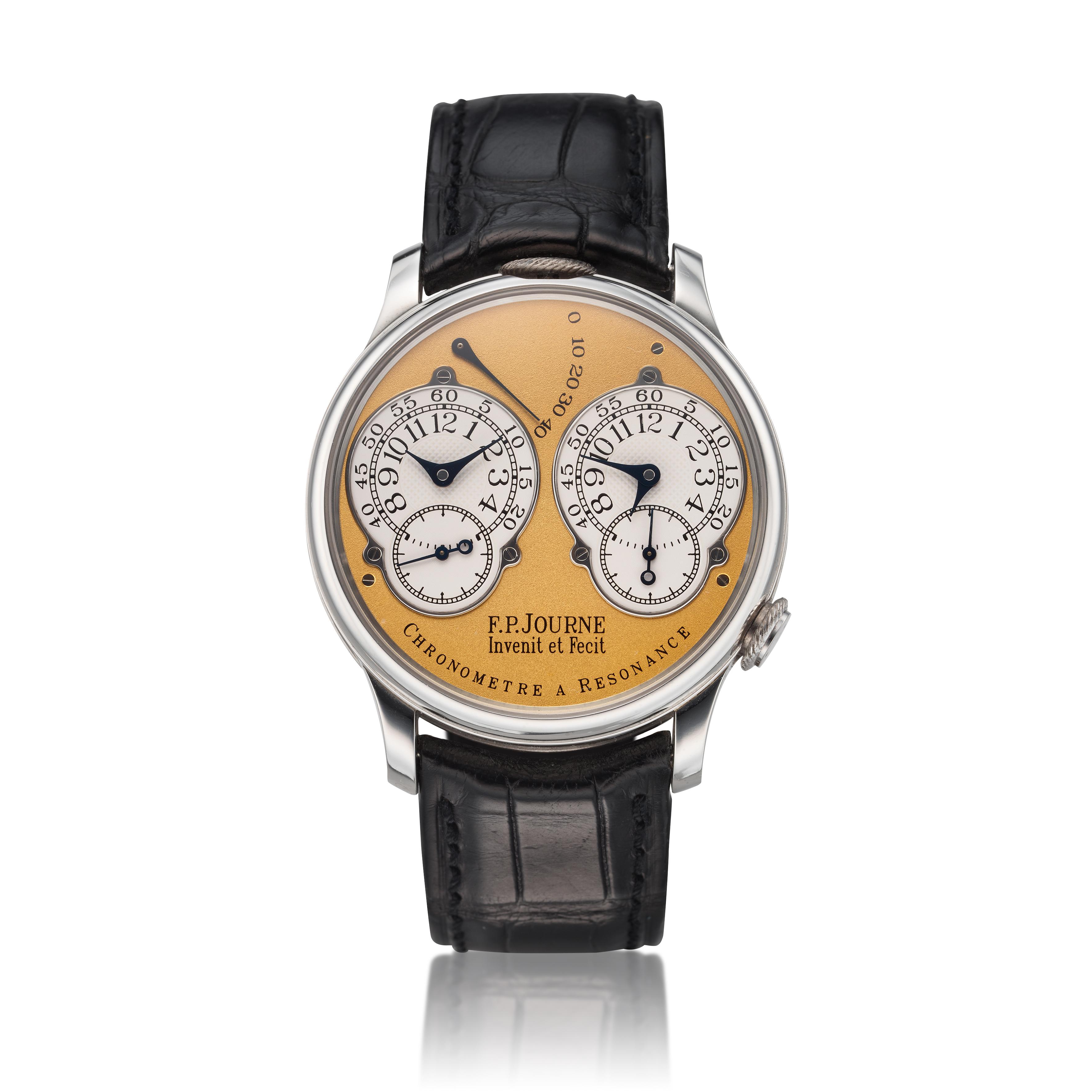 View full screen - View 1 of Lot 422. Chronomètre à Résonance  A platinum dual time wristwatch with power reserve indication and brass movement, Circa 2002 .