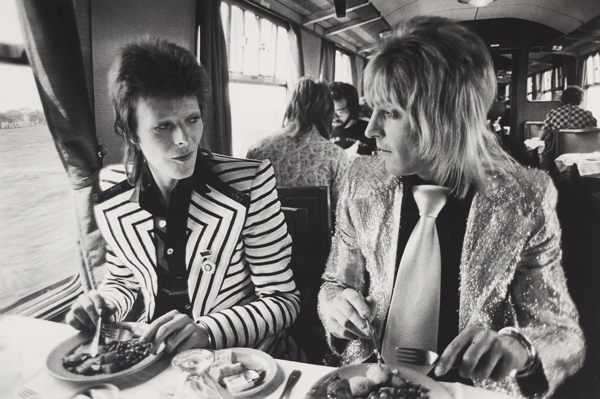 MICK ROCK | DAVID BOWIE AND MICK RONSON, LUNCH ON TRAIN TO ABERDEEN, SCOTLAND, 1973