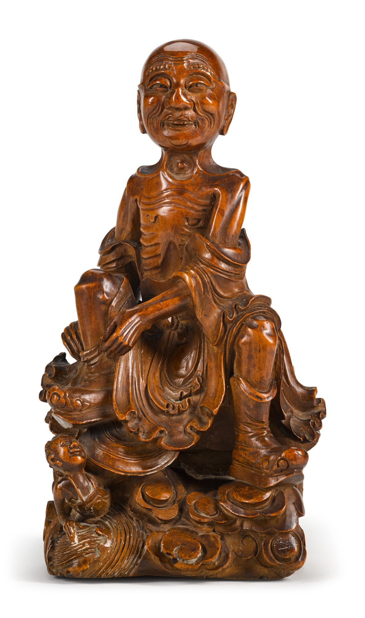 A BOXWOOD CARVING OF A LUOHAN | 19TH/20TH CENTURY | 十九/二十世紀 黃楊木雕羅漢坐像