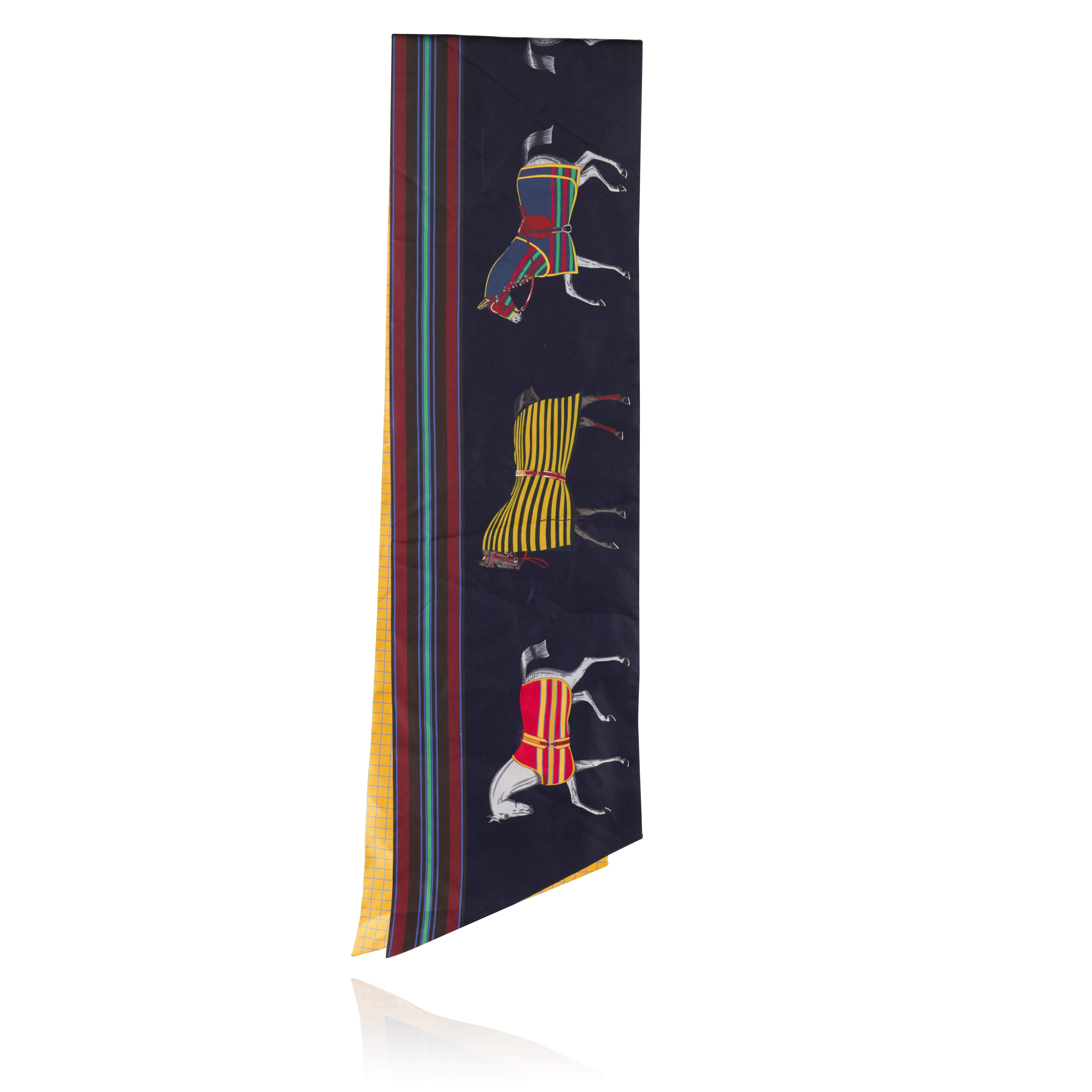 View full screen - View 1 of Lot 135. Dark Blue with Multicolour Hermès Horses Silk Maxi Twilly, 2018.