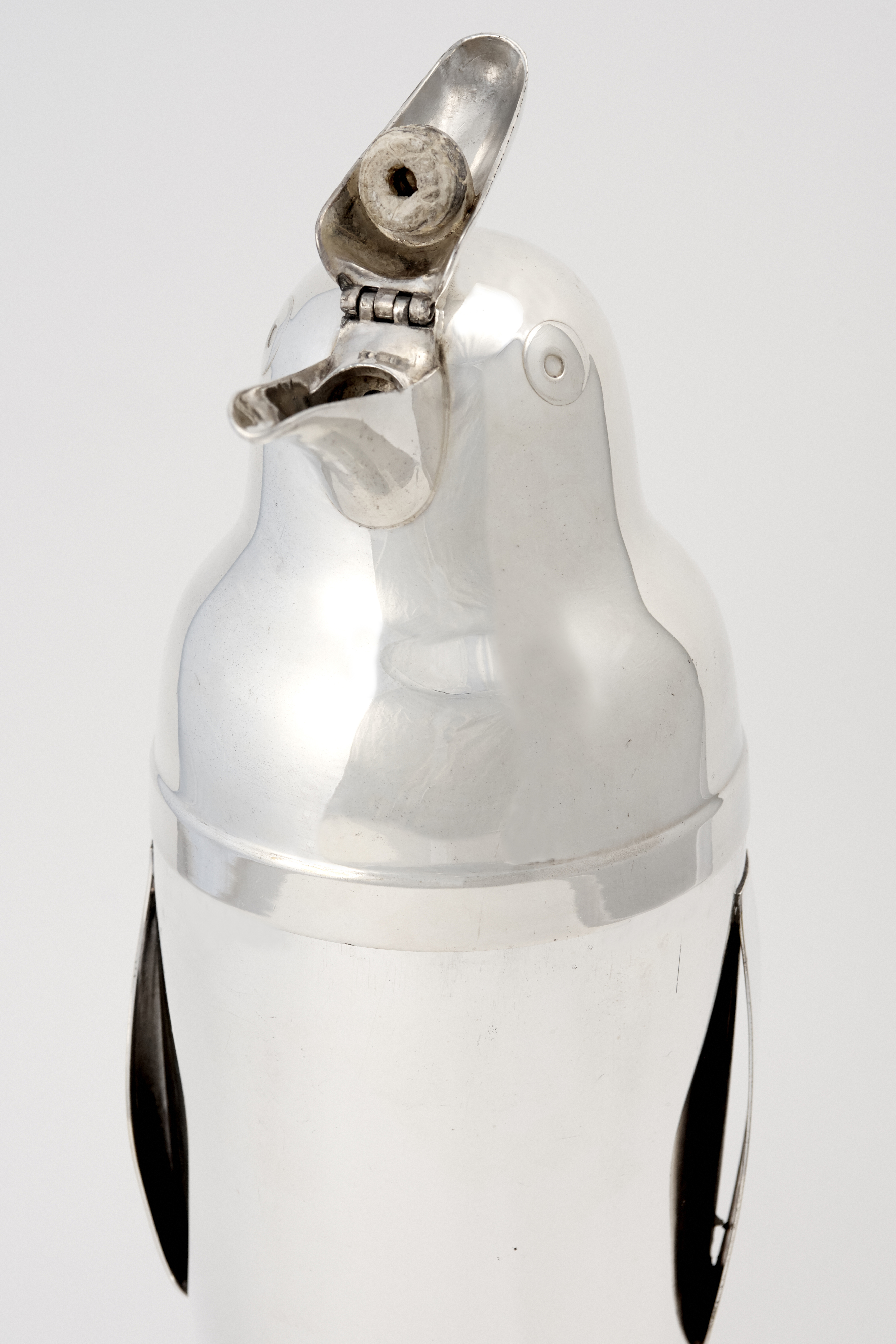 View full screen - View 1 of Lot 6.  AN AMERICAN SILVER-PLATED PENGUIN-FORM COCKTAIL SHAKER .