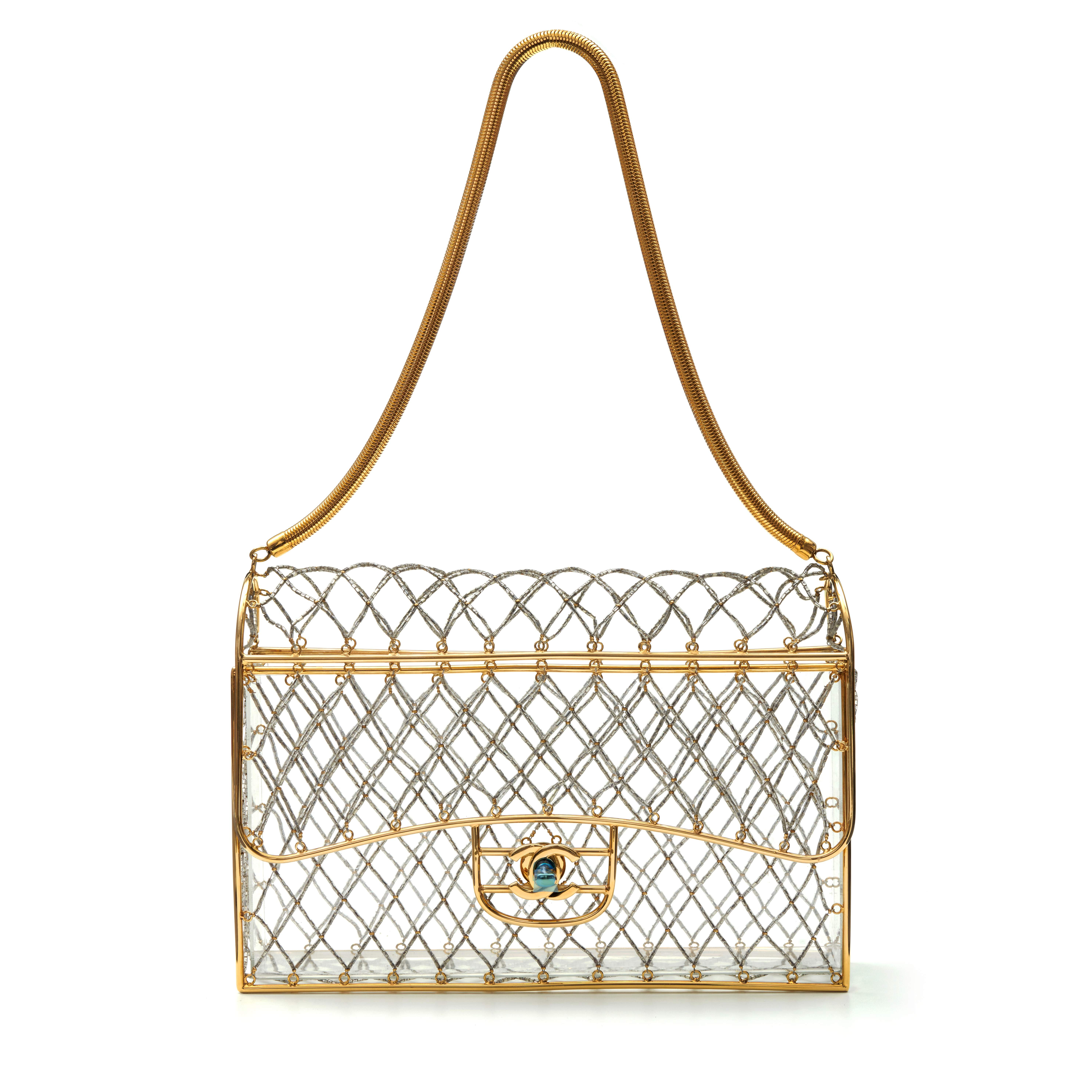 View full screen - View 1 of Lot 359. Clear Cage Bag in Lucite with Beading, Gold Tone Frame and Chain Strap, circa 1990s.