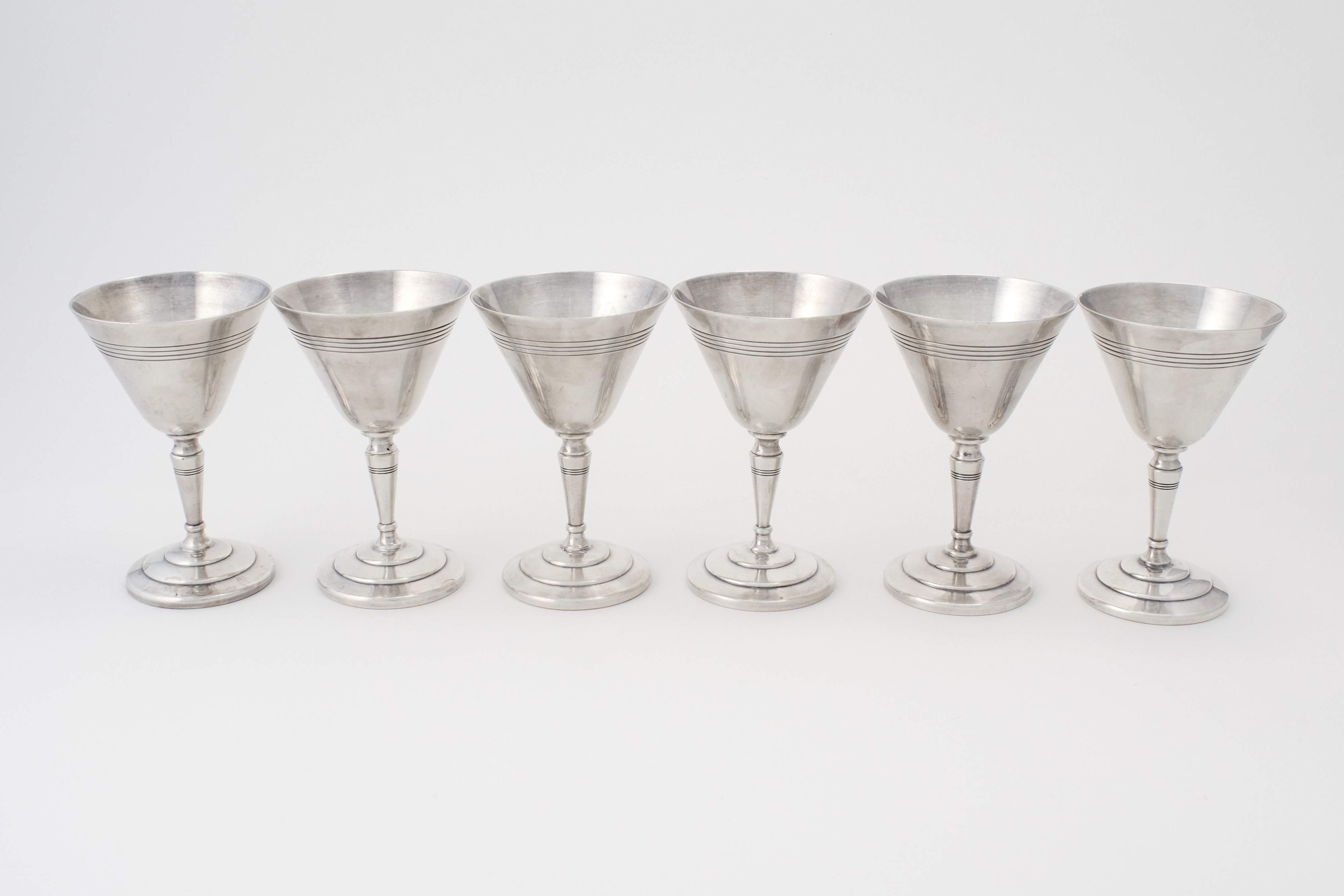 View 1 of Lot 8. A SET OF SIX ENGLISH SILVER-PLATED COCKTAIL GLASSES .