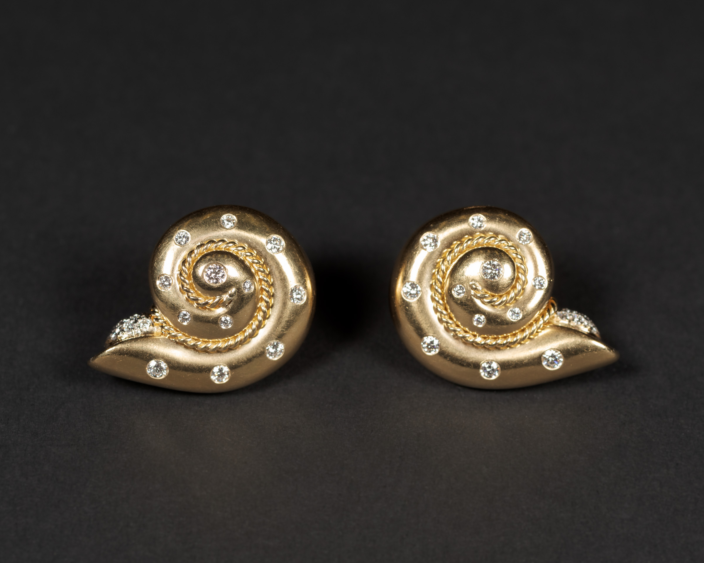 View full screen - View 1 of Lot 39. Smooth Snail Diamond Earrings .