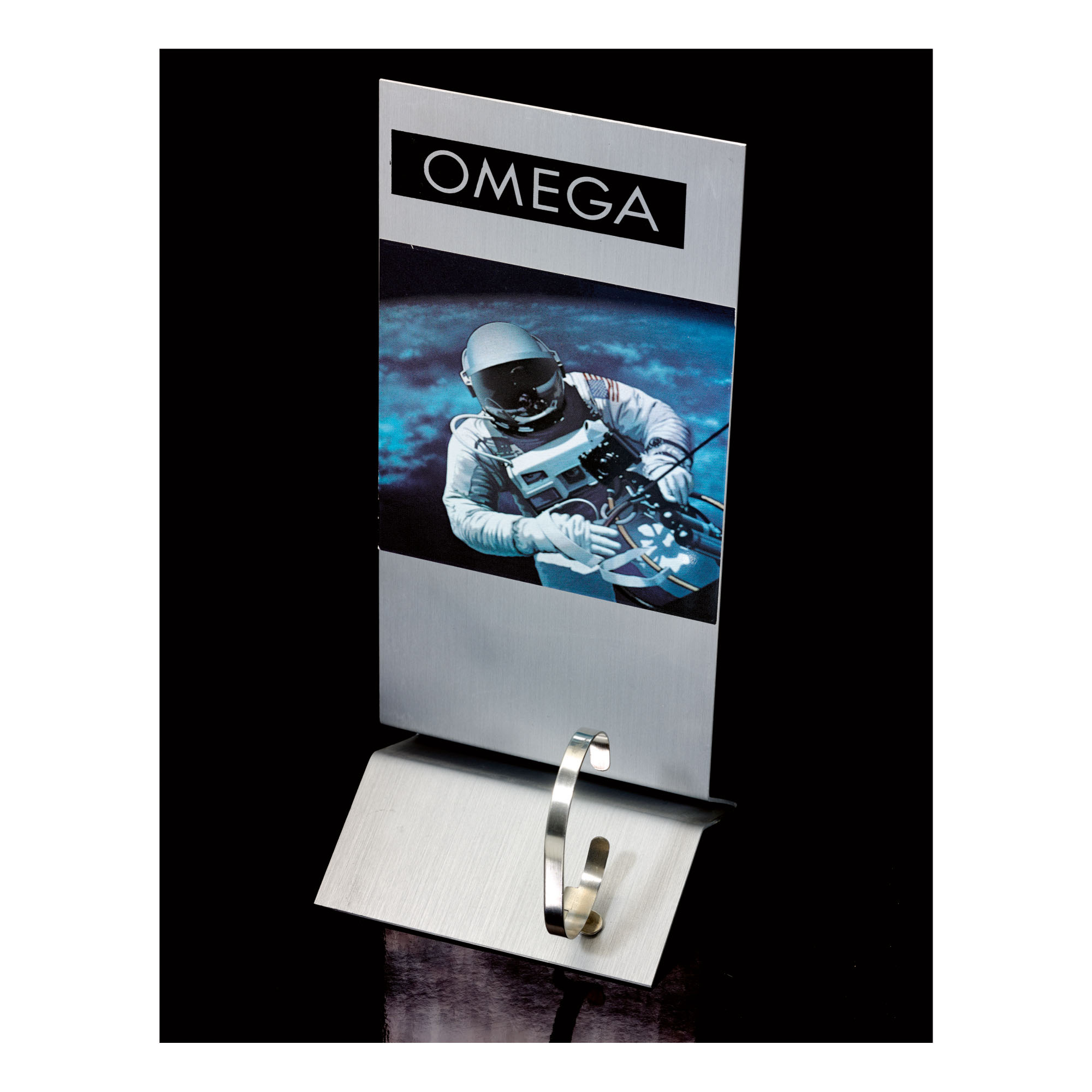 OMEGA | A STAINLESS STEEL OMEGA ADJUSTABLE WATCH STAND DEPICTING AN ASTRONAUT, CIRCA 1995