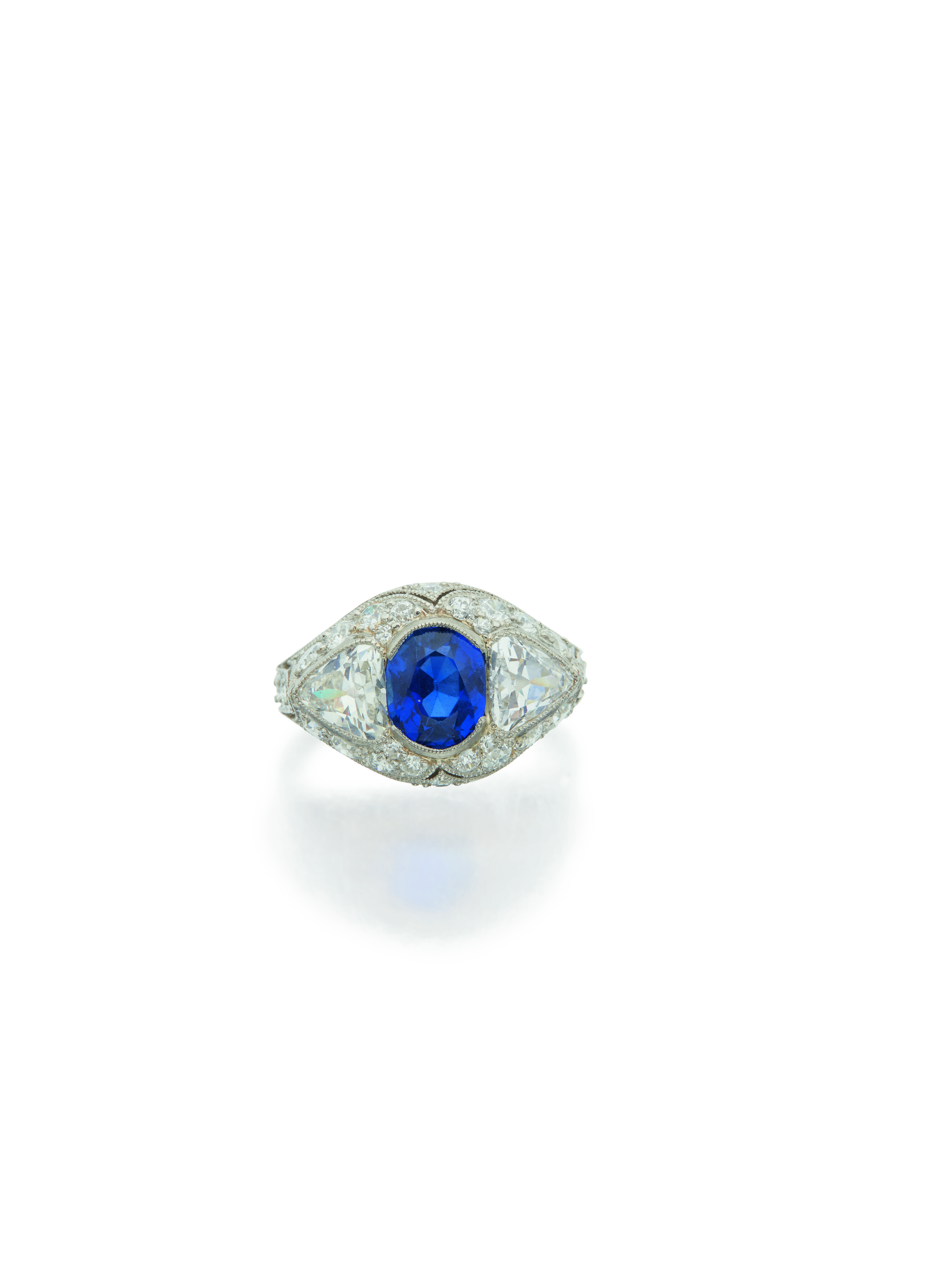 View 1 of Lot 34. DIAMOND AND SAPPHIRE RING.