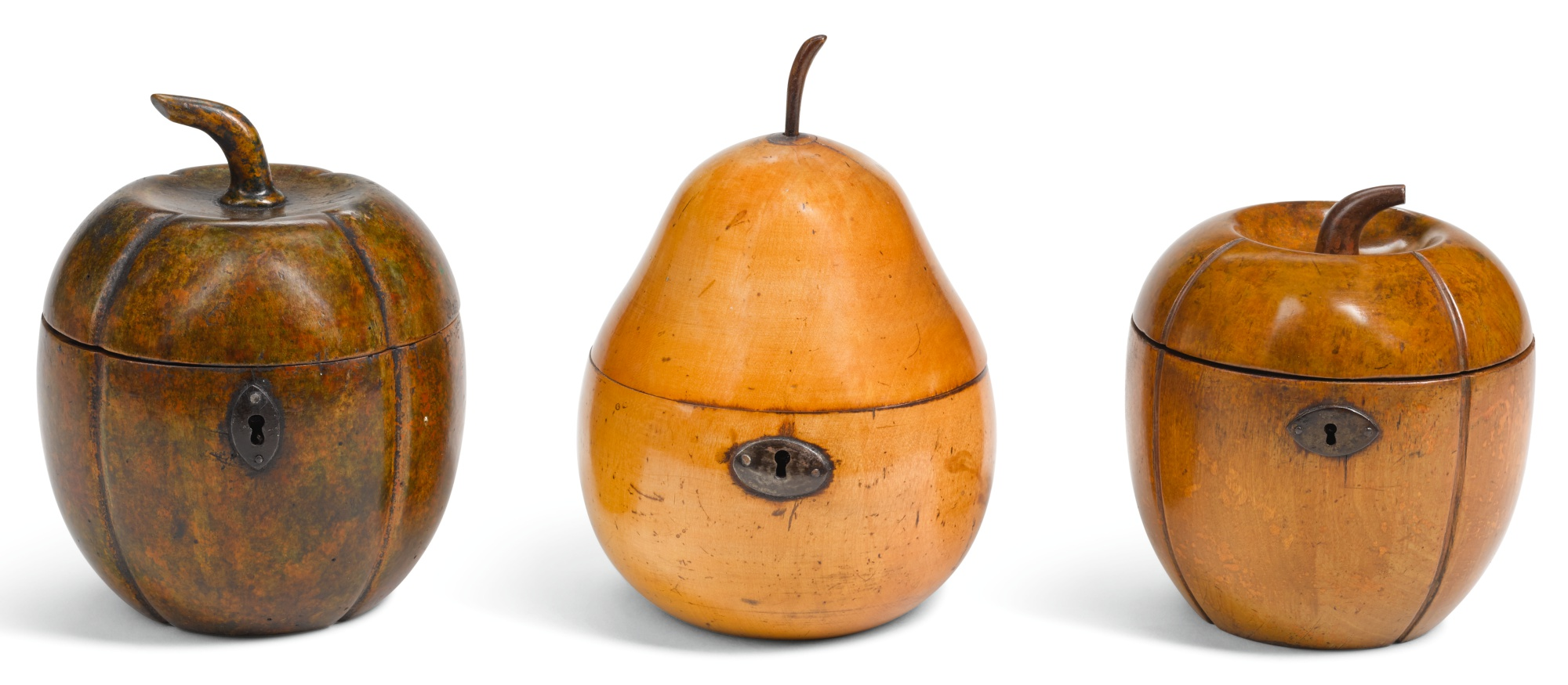 THREE GEORGE III FRUITWOOD TEA CADDIES, CIRCA 1800, ONE IN THE FORM OF A PEAR, TWO IN THE FORM OF A MELON