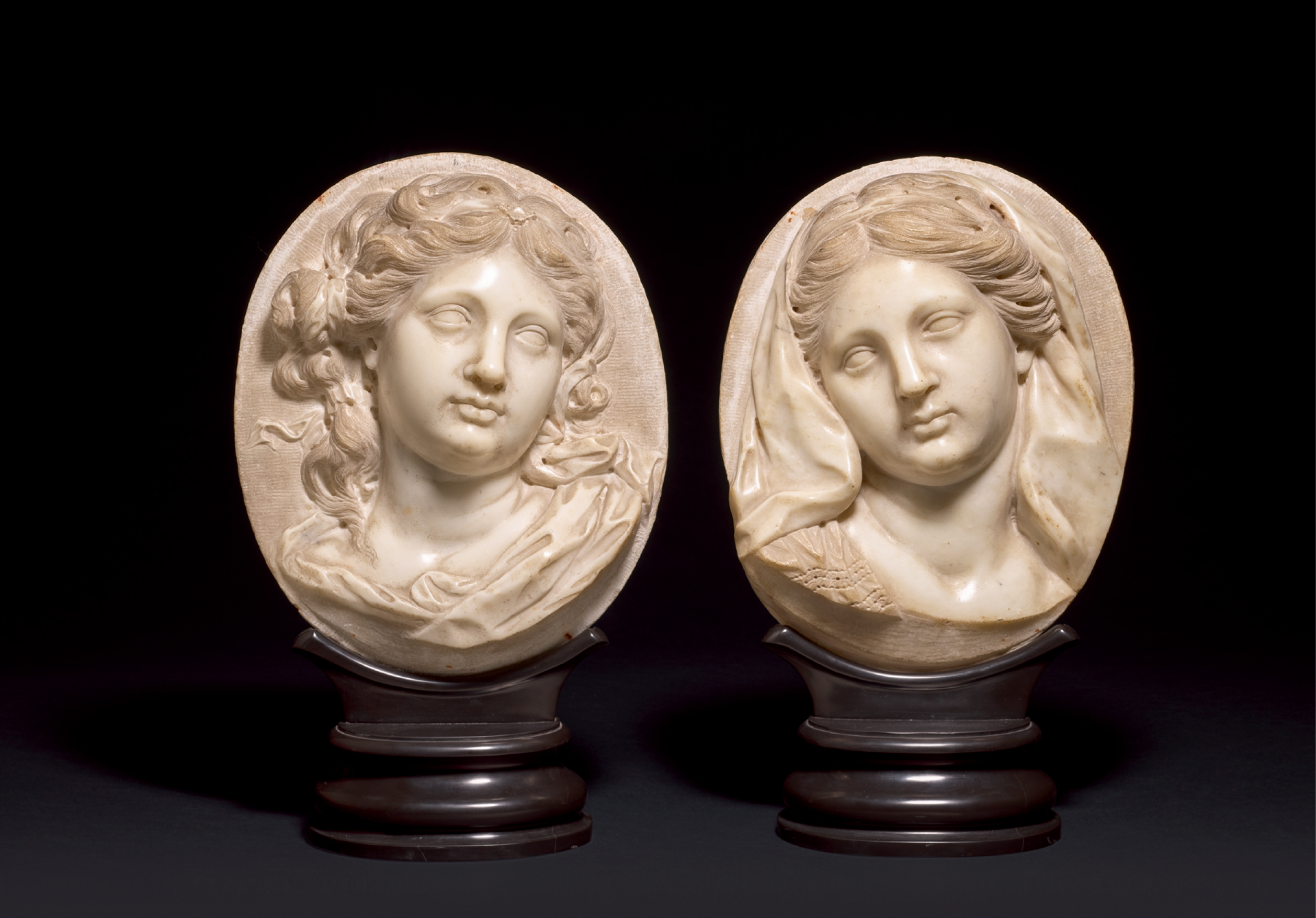 View full screen - View 1 of Lot 94. ATTRIBUTED TO GIOVANNI BONAZZA (1654-1736), NORTHERN ITALIAN, 18TH CENTURY | PAIR OF RELIEFS WITH BUSTS OF WOMEN.