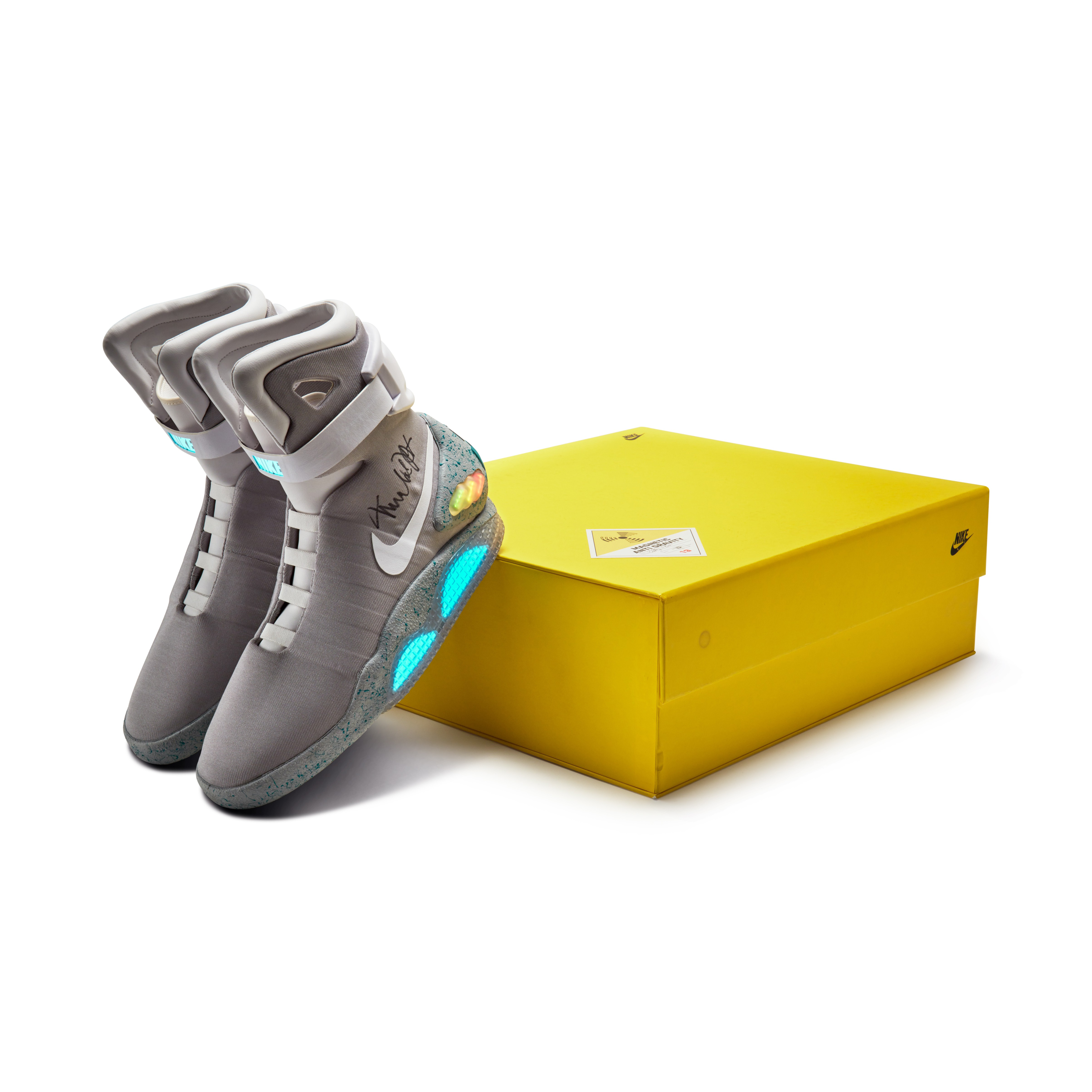View full screen - View 1 of Lot 1. Michael J. Fox Dual Signed Nike MAG 'Back to the Future' | 2011.