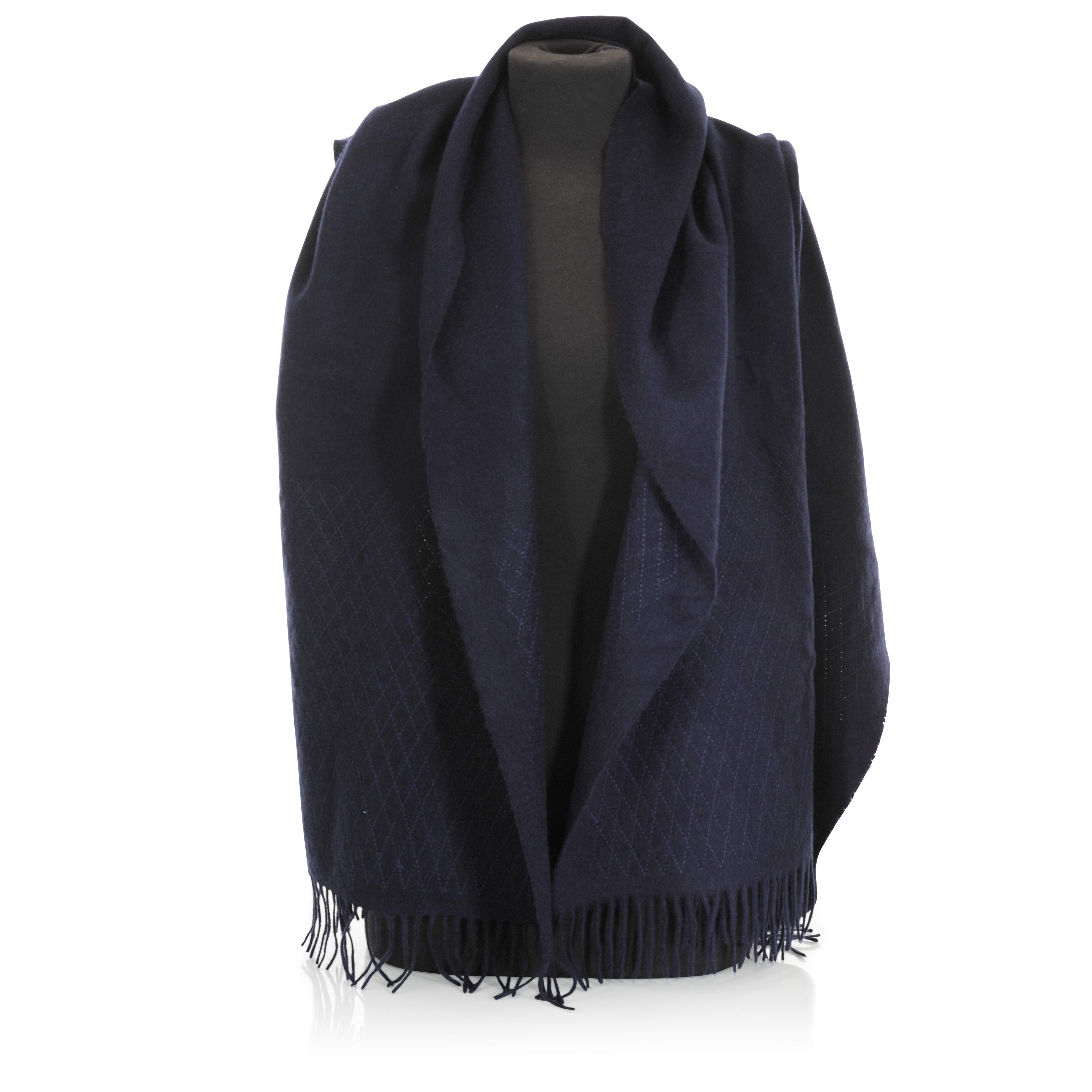 View full screen - View 1 of Lot 198. CHANEL | BLUE CASHMERE DIAMOND STITCH DETAIL SHAWL, 2018.