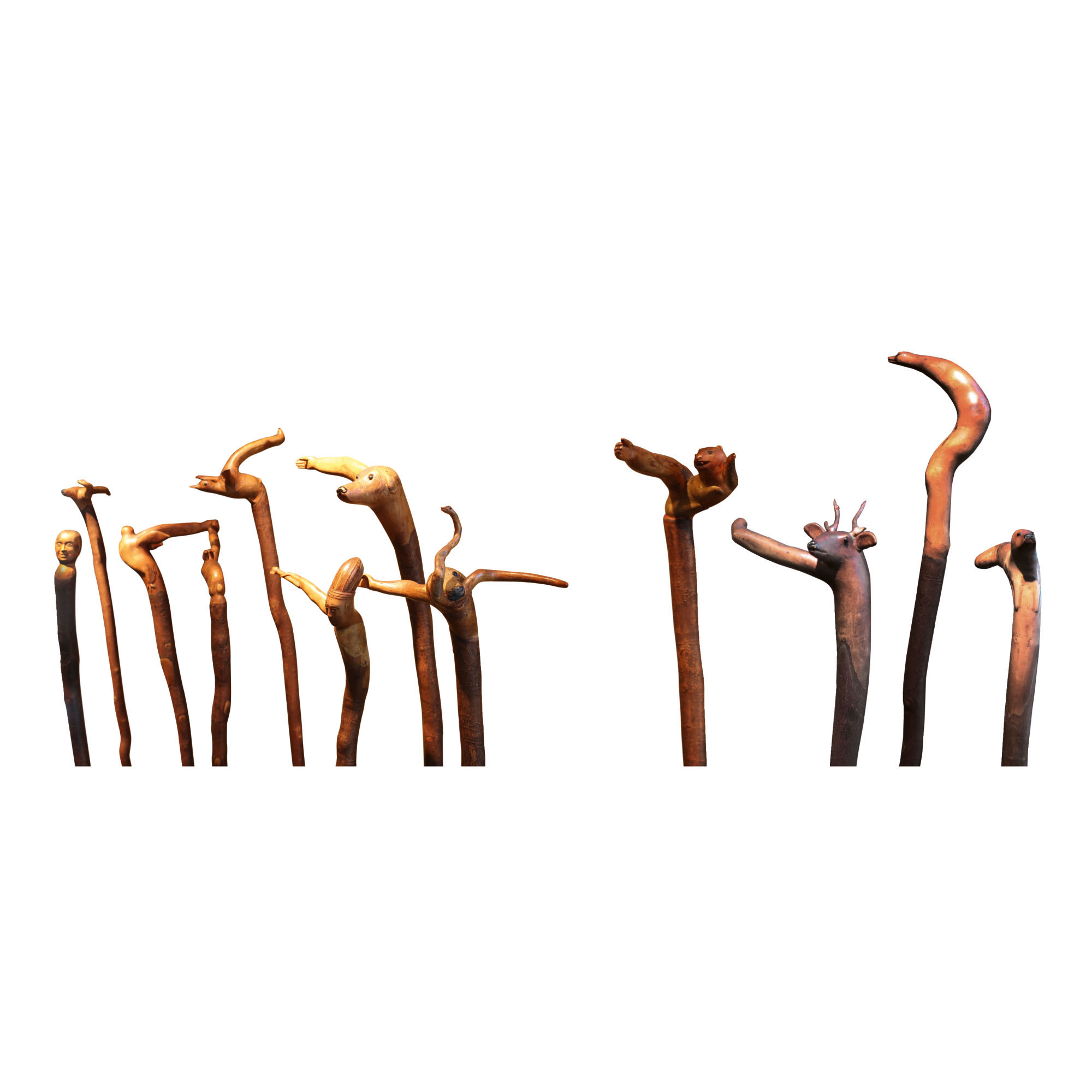 TWELVE EXCEPTIONAL FIGURATIVELY CARVED WOODEN WALKING STICKS, 20TH CENTURY