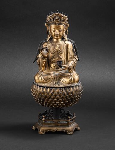 View 1. Thumbnail of Lot 39. Statue de Guanyin en bronze doré Dynastie Ming, XVIIE siècle | 明十七世紀 鎏金銅觀音菩薩坐像 | A large gilt-bronze figure of Guanyin on a lotus base, Ming Dynasty, 17th century.