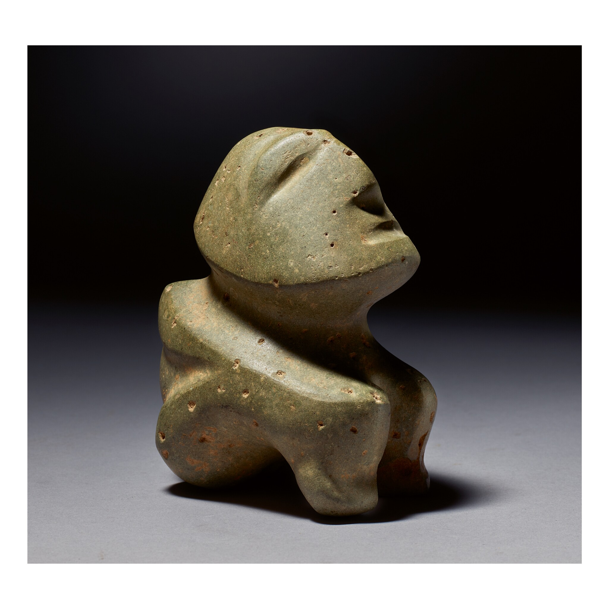 View full screen - View 1 of Lot 135. MEZCALA STONE SEATED FIGURE LATE PRECLASSIC, CIRCA 300 - 100 BC.