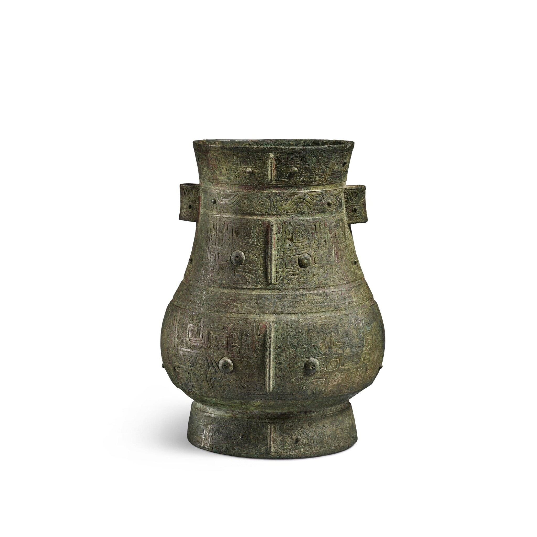 View full screen - View 1 of Lot 8. A magnificent and rare archaic bronze ritual wine vessel (Hu), Late Shang dynasty   商末 青銅饕餮紋壺.