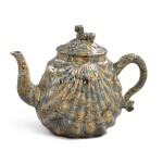 A STAFFORDSHIRE SOLID-AGATE PECTEN-SHELL TEAPOT AND COVER, CIRCA 1750