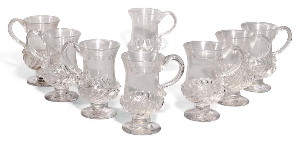 A SET OF EIGHT FLUTED GLASS COIN MUGS, 19TH/20TH CENTURY