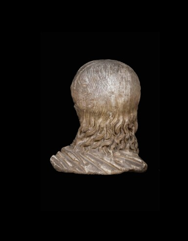 View 3. Thumbnail of Lot 66. A Roman Marble Portrait Head of a Boy, circa 2nd half of the 1st Century A.D..