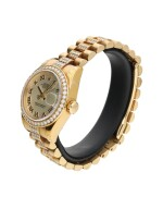 ROLEX     REFERENCE 179138 DATEJUST  A YELLOW GOLD AND DIAMOND-SET AUTOMATIC WRISTWATCH WITH DATE AND BRACELET, CIRCA 2005