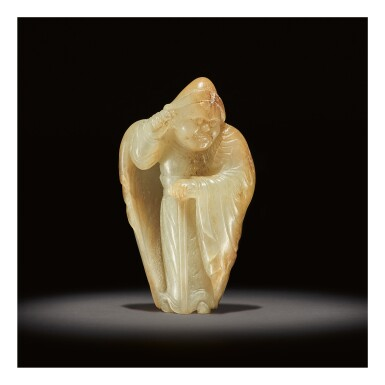 View 1. Thumbnail of Lot 207. AN EXCEEDINGLY RARE WHITE AND RUSSET JADE CARVING OF A FOREIGNER,  TANG DYNASTY.