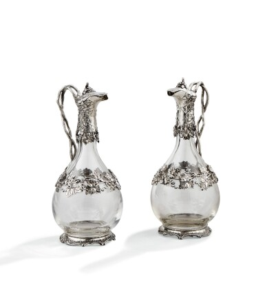 A PAIR OF CUT-GLASS DECANTERS WITH SILVER MOUNTS, ODIOT, PARIS, 20TH CENTURY | PAIRE D'AIGUIERES EN VERRE MONTE EN ARGENT PAR ODIOT, PARIS, XXE SIECLE