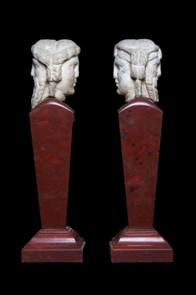 View 4. Thumbnail of Lot 97. Two Roman Marble Janiform Herm Heads, circa 2nd century A.D., mounted as a pair on red marble shafts, probably in the 19th Century, circa 1st Century A.D..