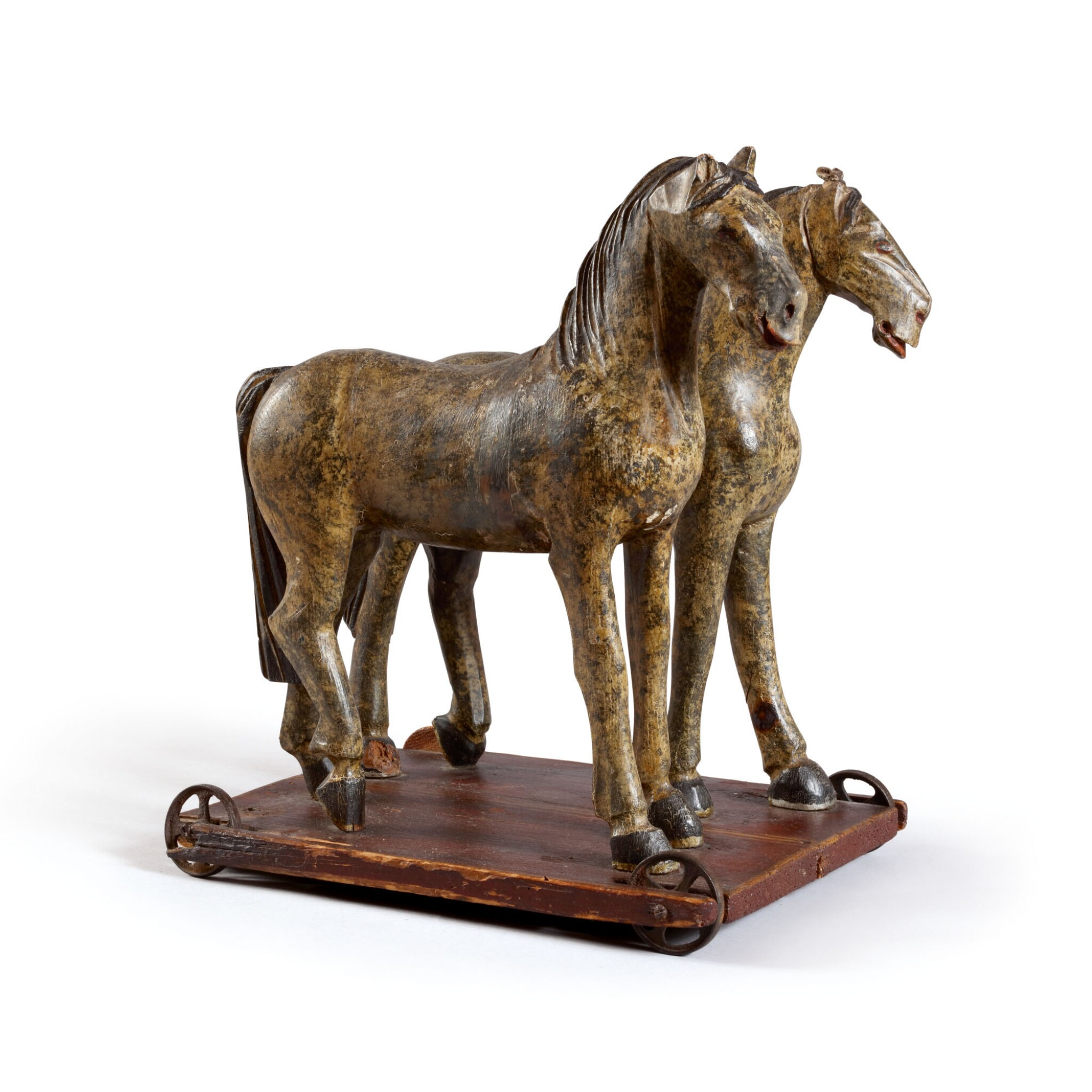 FINE CARVED AND DAPPLED PAINTED PINE HORSES PULL TOY, LATE 19TH CENTURY
