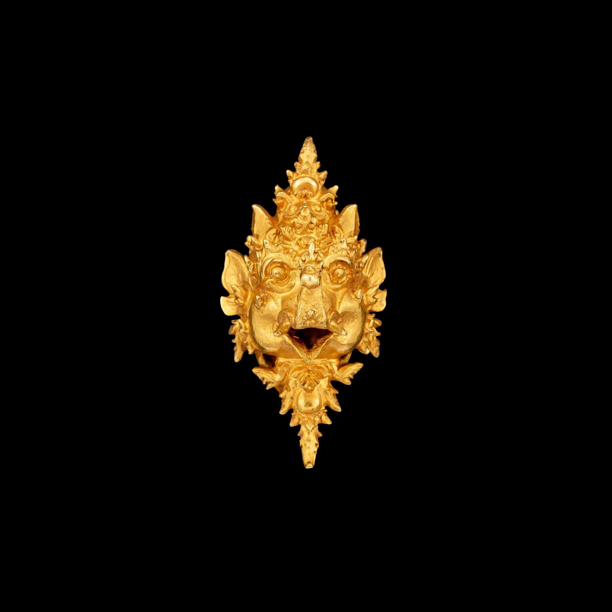 View full screen - View 1 of Lot 1036. A gold 'Makara' ear clip East Java, Indonesia, 13th - 15th century | 十三至十五世紀 印尼東爪哇 摩羯形金耳夾.