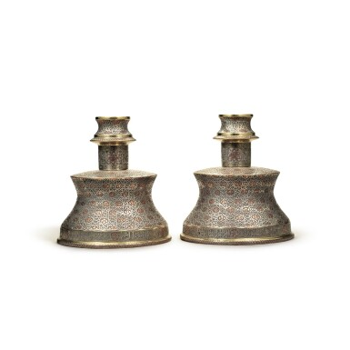 View 2. Thumbnail of Lot 137. A pair of Cairoware silver and copper-inlaid candlesticks, Egypt or Syria, 20th century.