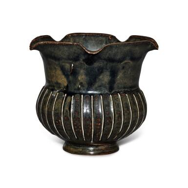 View 1. Thumbnail of Lot 199. A black-glazed ribbed vase, Northern Song / Jin dynasty | 北宋 / 金 黑釉棱線紋花口罐.
