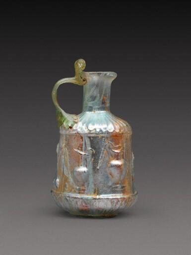 View 2. Thumbnail of Lot 4. A Roman Pale Green Mould-Blown Glass Flask, circa 1st century A.D..