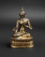 Figure de Tara Blanche en cuivre doré repoussé Tibet, XVIIIE siècle | 西藏 十八世紀 鎏金銅白度母坐像 | A gilt-copper repoussé figure of the white Tara, Tibet 18th century