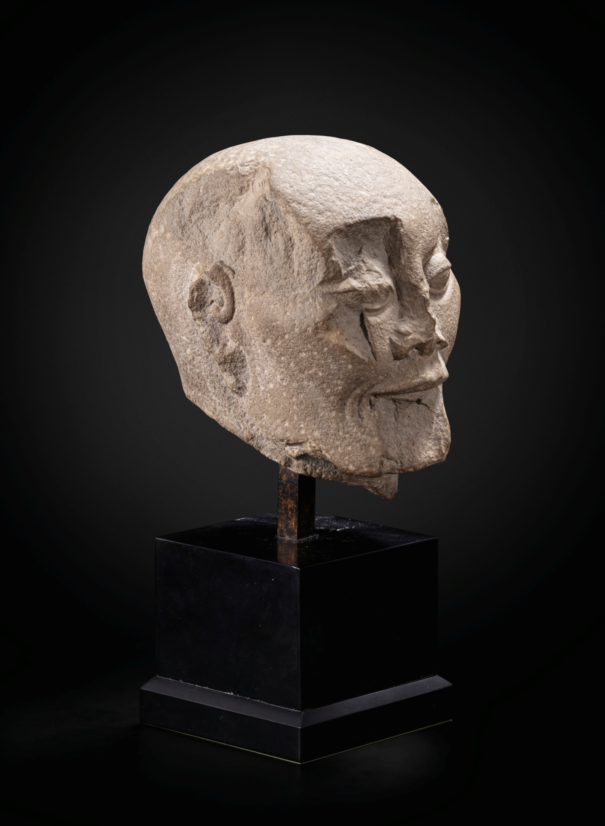 View full screen - View 1 of Lot 195. A carved limestone head of a fasting Luohan Song dynasty   宋 石灰石雕羅漢首像.