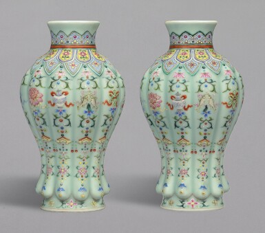 View 1. Thumbnail of Lot 20. A RARE PAIR OF FINELY DECORATED CELADON-GROUND FAMILLE-ROSE 'BAJIXIANG' LOBED VASES, QIANLONG SEAL MARKS AND PERIOD | 清乾隆 粉青地粉彩八吉祥紋瓜棱式瓶一對 《大清乾隆年製》款.