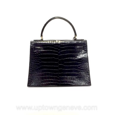 View 4. Thumbnail of Lot 743. HERMÈS | BLACK KELLY 28 IN SHINY CROCODILE WITH GOLD HARDWARE, 1962.