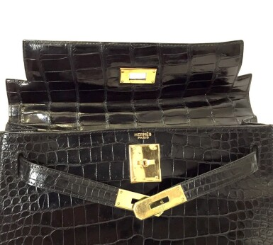View 19. Thumbnail of Lot 743. HERMÈS | BLACK KELLY 28 IN SHINY CROCODILE WITH GOLD HARDWARE, 1962.