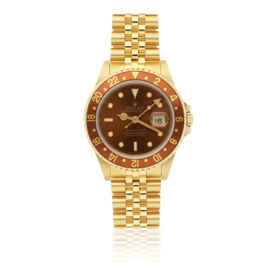 View 1. Thumbnail of Lot 161. ROLEX   GMT-MASTER II REF 16718, A YELLOW GOLD AUTOMATIC DUAL TIME WRISTWATCH WITH DATE AND BRACELET CIRCA 1990.