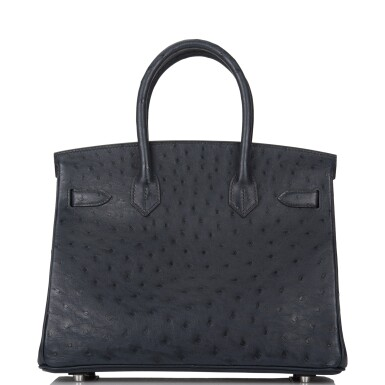 View 4. Thumbnail of Lot 2. Hermès Bleu Indigo Birkin 30cm of Ostrich with Palladium Hardware.