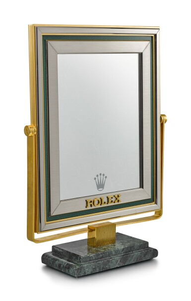 View 2. Thumbnail of Lot 8138. ROLEX   A RETAILER'S DISPLAY MIRROR WITH MARBLE STAND, CIRCA 1980.