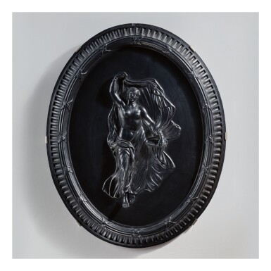 A WEDGWOOD BLACK BASALT OVAL PLAQUE OF A DANCING MAENAD LATE 18TH CENTURY