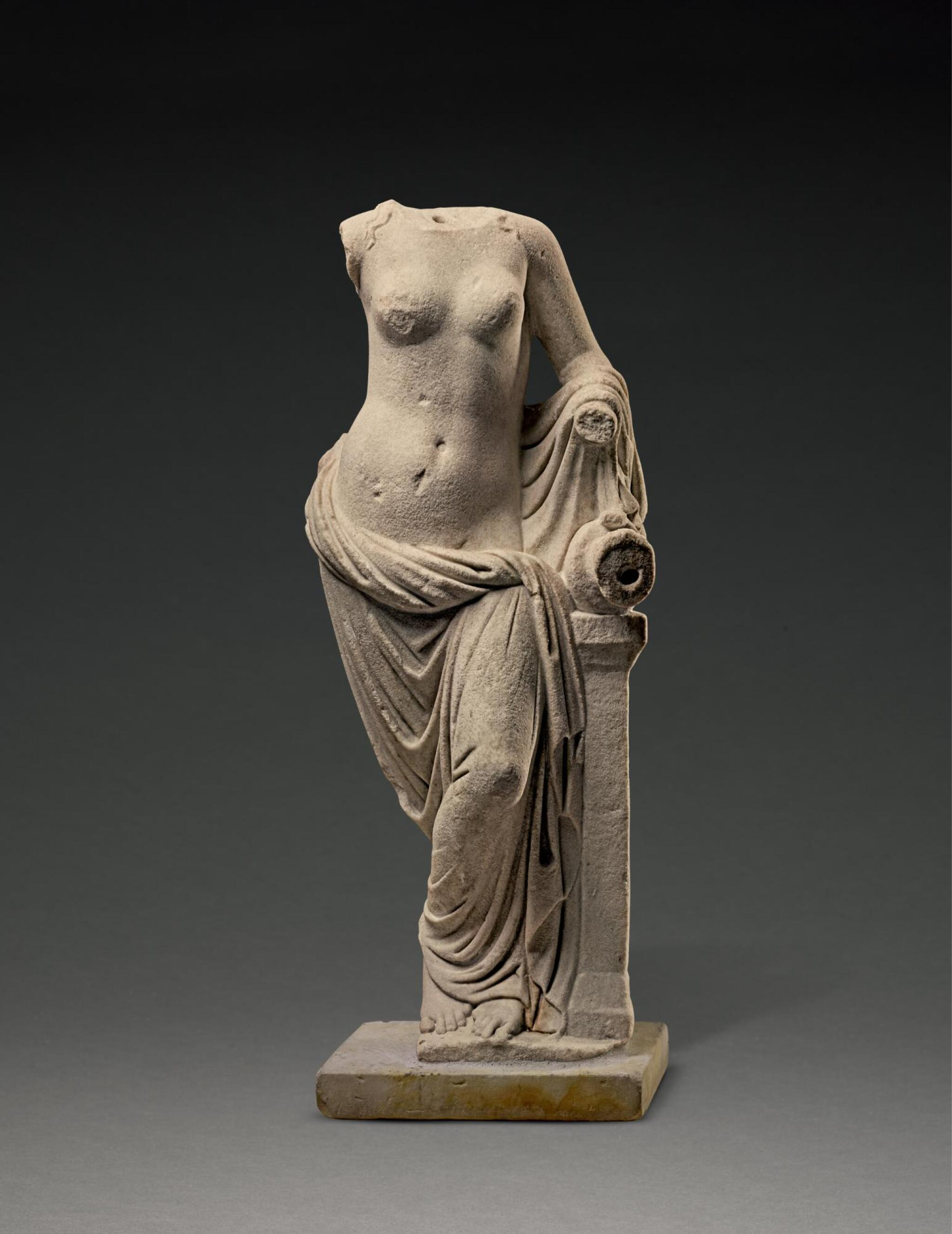 View full screen - View 1 of Lot 241. A ROMAN MARBLE FOUNTAIN FIGURE OF A NYMPH, CIRCA 2ND CENTURY A.D..