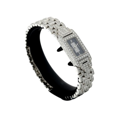 View 3. Thumbnail of Lot 74. A LADY'S WHITE GOLD AND DIAMOND SET BRACELET WATCH WITH ONYX AND DIAMOND-SET DIAL, CIRCA 2005.