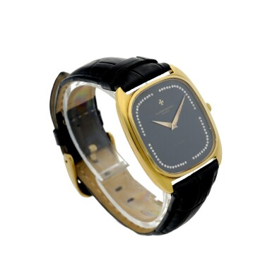 View 3. Thumbnail of Lot 804. REFERENCE 44003 A YELLOW GOLD CUSHION SHAPED AUTOMATIC WRISTWATCH WITH DIAMOND-SET ONYX DIAL, CIRCA 1985.