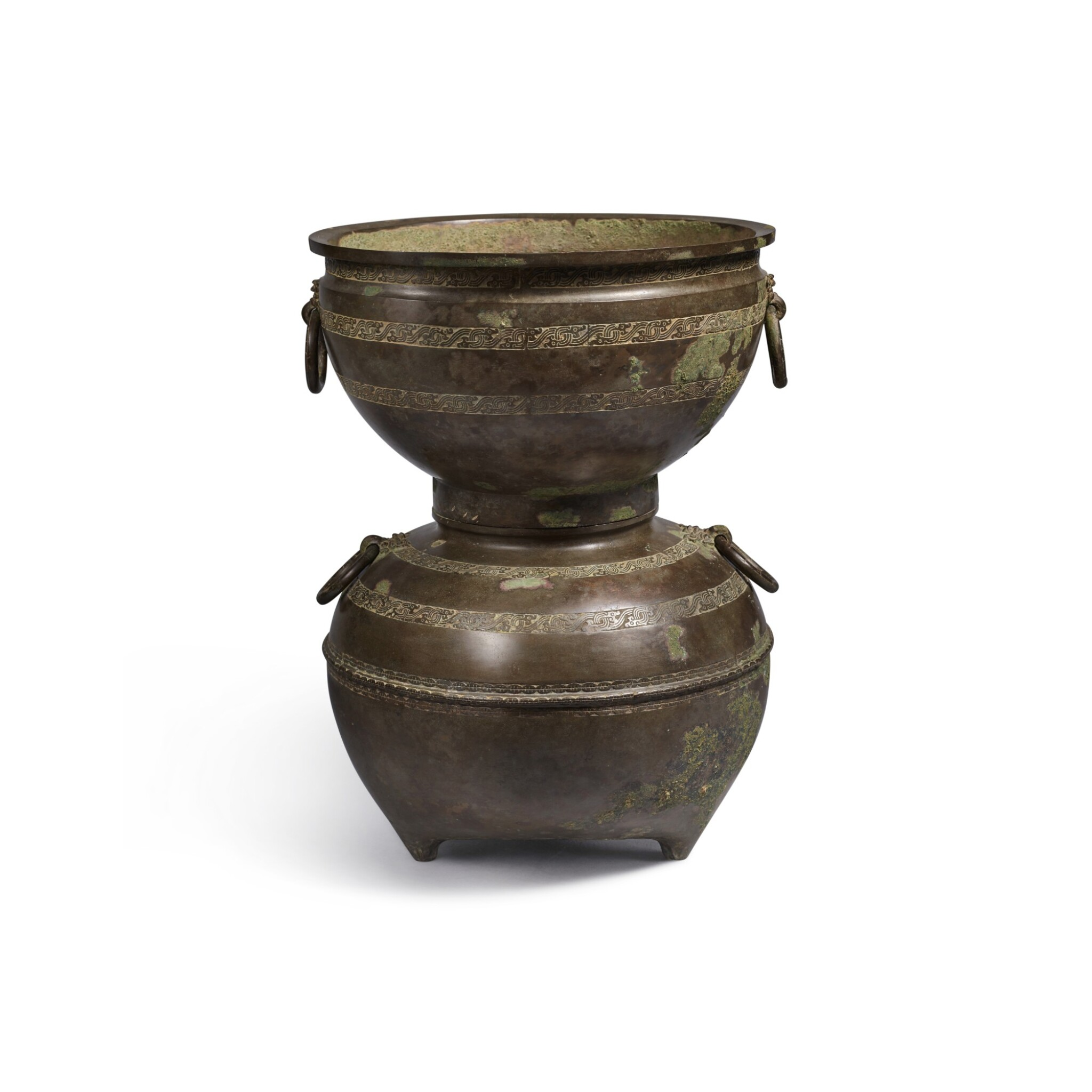 View full screen - View 1 of Lot 20. An archaic bronze ritual food steamer (Yan), Eastern Zhou dynasty, early Warring States period   東周 戰國初 青銅交龍紋鋪首耳甗.
